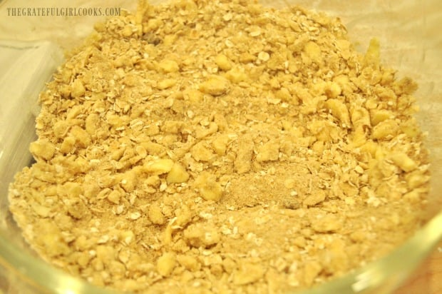 Streusel topping is blended, and ready to put on top of apple pie dessert pizza.