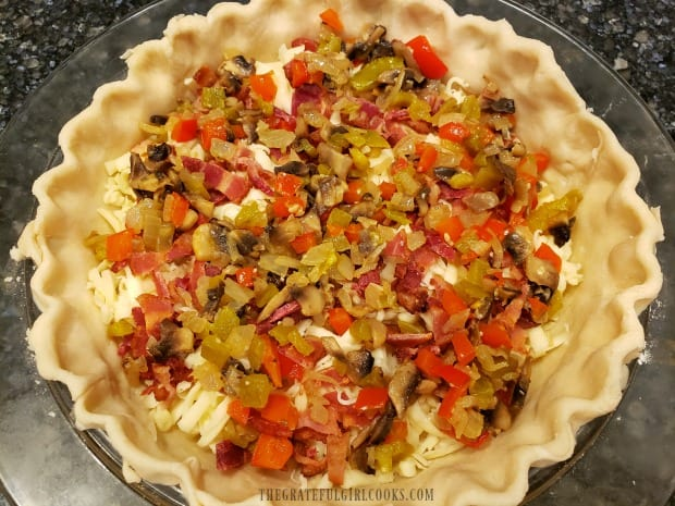 Veggie filling is added to bacon and cheese in this Southwestern bacon quiche.
