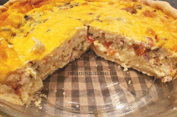 Southwestern bacon quiche with a couple slices taken out of it.