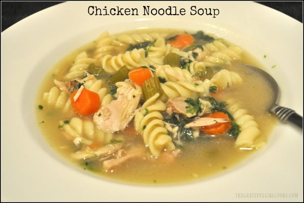 Delicious, homemade chicken noodle soup, with leftover rotisserie chicken, celery, carrots, garlic, onions and spinach will warm you up on a cold day!