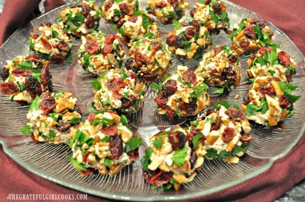 Cranberry pecan goat cheese bites are on a plate.