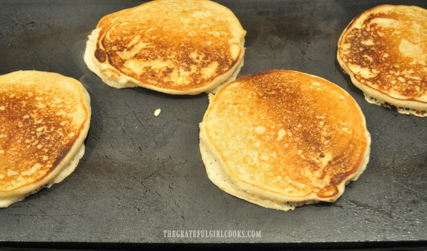 The apple pie pancakes are turned when nicely browned, to finish cooking.