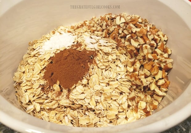 Oats, chopped pecans and spices are mixed together for blueberry baked oatmeal.