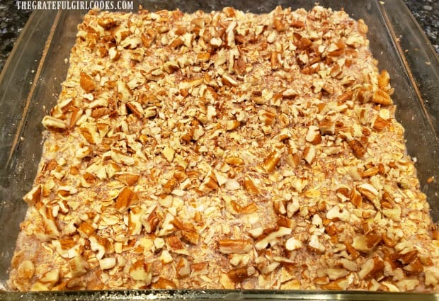 Chopped pecans are added to top of blueberry baked oatmeal before baking.