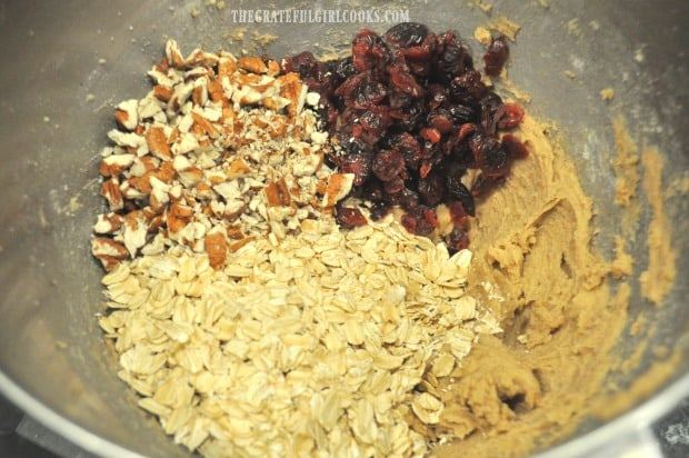 Rolled oats, dried cranberries and pecans are added to the cookie dough,