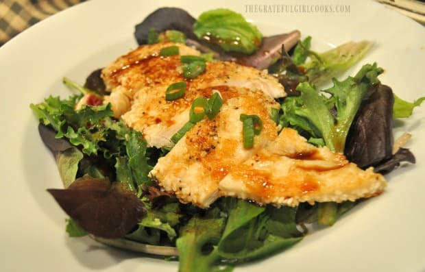 A side view of the ginger chicken salad with ginger dressing in white bowl.