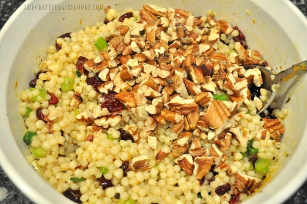 Toasted, chopped pecans are added to the cranberry orange Israeli couscous, before serving.