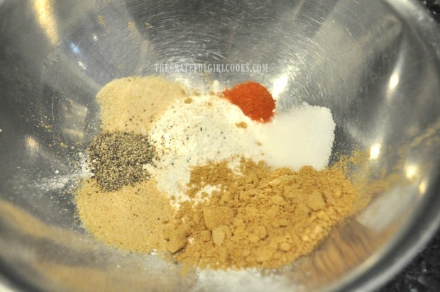 Spices are mixed to apply to chicken wings, before baking.