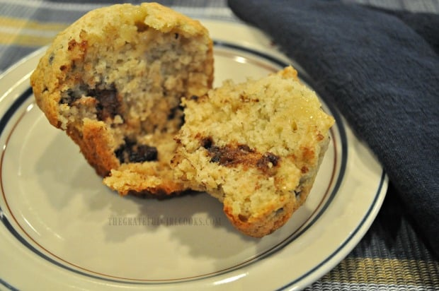 One of the banana chocolate chip muffins, sliced in half to show the inside.