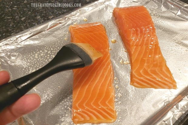Honey and water glaze is brushed onto salmon before broiling.