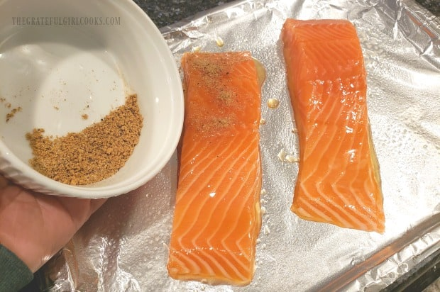 The broiled salmon recipe calls for sprinkling fillets with spice mix before broiling.