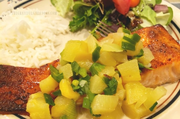 Close up photo of the pineapple salsa on top of the seasoned broiled salmon.