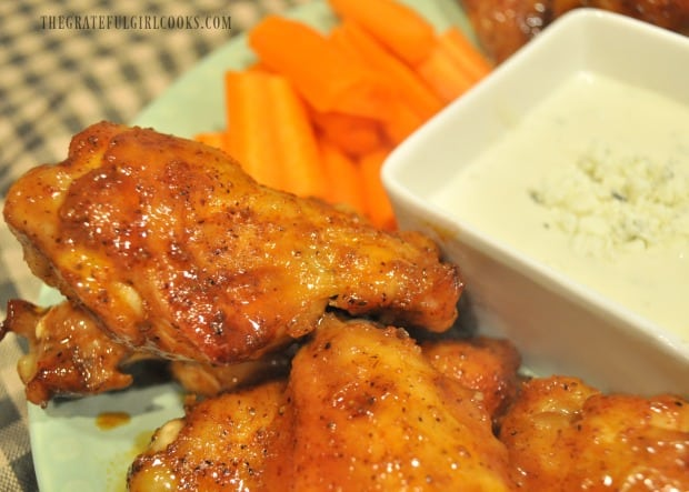 Here's a close up of the buffalo honey hot wings on plate, with bleu cheese dressing and carrots on the side.
