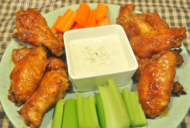 A platter of buffalo honey hot wings, served with bleu cheese dressing, celery and carrots.