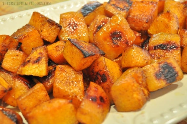 Once done, the maple cinnamon butternut squash is transferred to serving platter before serving.