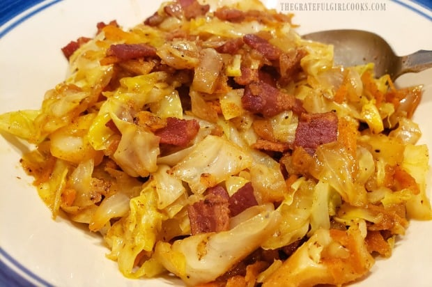 Fried cabbage, with bacon, onions, carrots and garlic is served as a side dish.