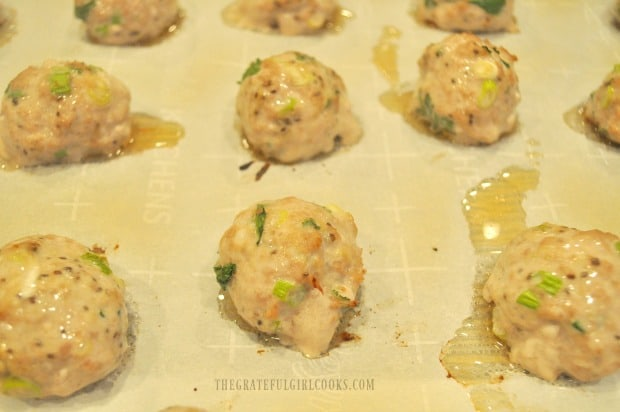 When the Thai turkey meatballs are halfway through baking, they are flipped to other side.
