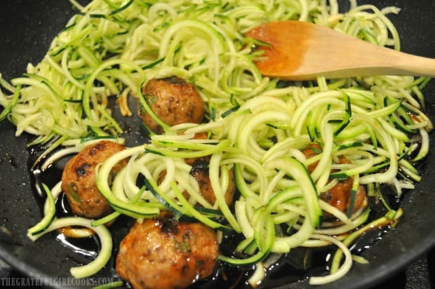 Thai turkey meatballs and zucchini noodles are added to glaze in skillet to cook for a few minutes.