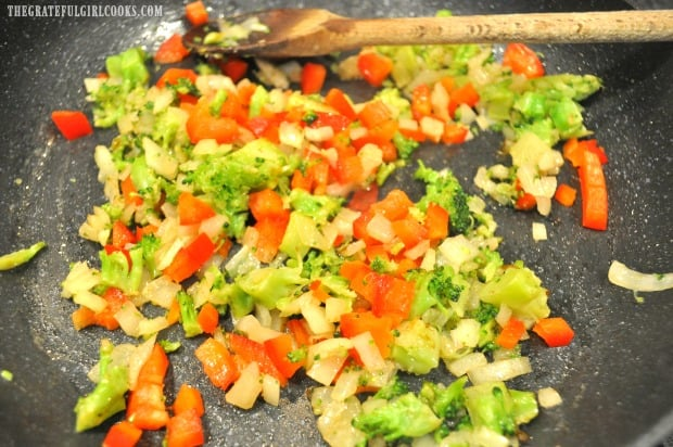 Chopped broccoli, red bell peppers, garlic and onion are cooked, before adding to the quiche.