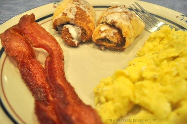The cooked bacon is done perfectly, and served with cinnamon crescent rolls and scrambled eggs!