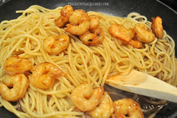 Marinated shrimp are added to the skillet with the sweet chili sauce and pasta.
