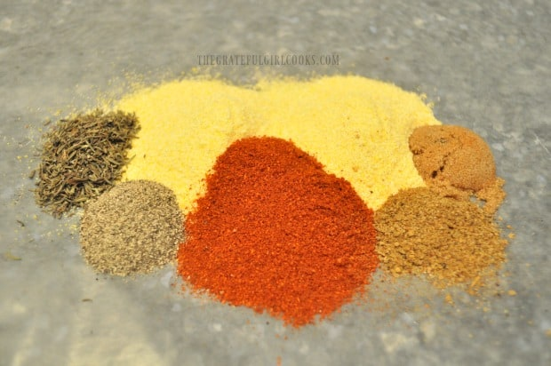 Spices are added to cornmeal to season the crust on the rockfish.