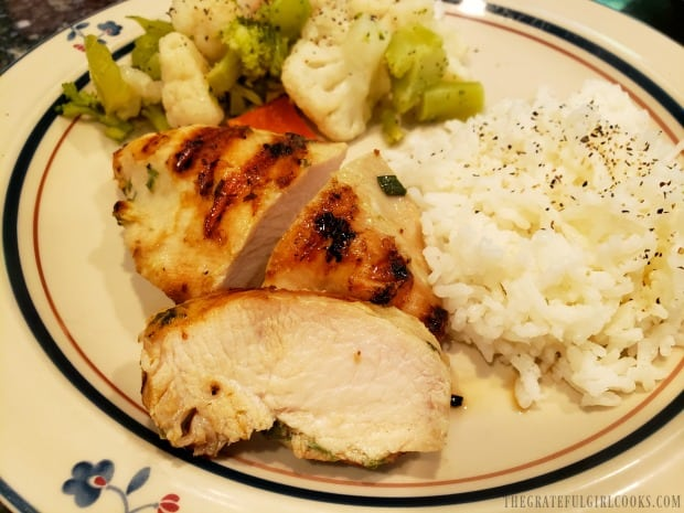 Flavorful garlic ginger sesame marinated chicken on plate with rice and steamed veggies.