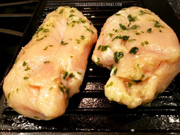 Marinated chicken is grilled on a hot, well-oiled grill pan.