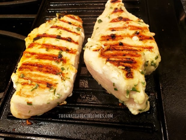 The garlic ginger sesame marinated chicken is turned over halfway through grilling time.