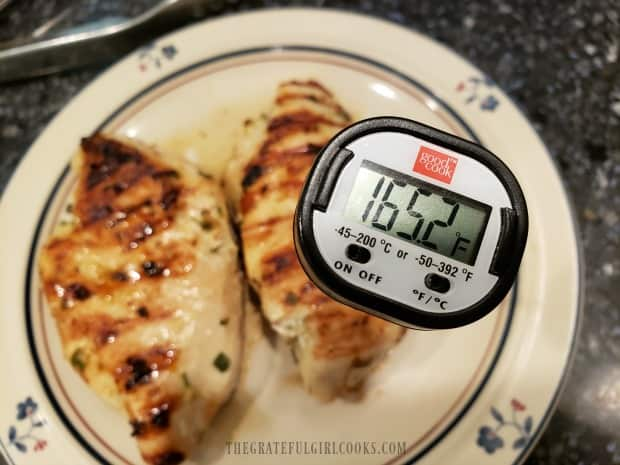 The meat thermometer says the chicken is fully cooked at 165 degrees F.