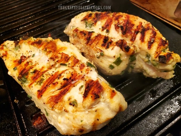 Two pieces of garlic ginger sesame marinated chicken cooking on indoor grill pan.
