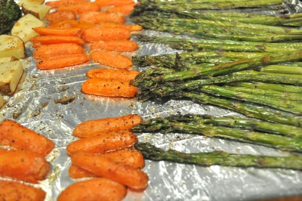 The oven roasted carrots and asparagus are finished cooking and are ready to serve.