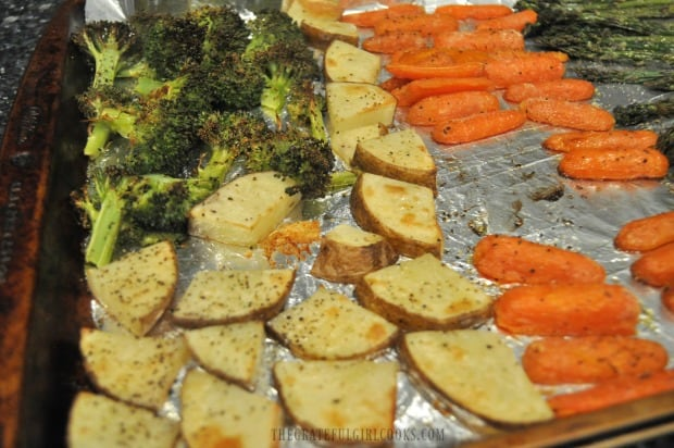 Potato slices, broccoli and carrots are done being oven roasted and are ready to eat!