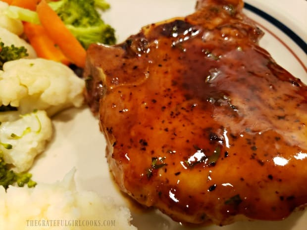 One of the skillet glazed pork chops, served with mashed potatoes and assorted veggies.