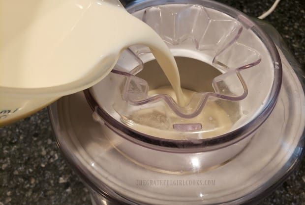 Pouring the ice cream base into the ice cream maker to begin freezing.