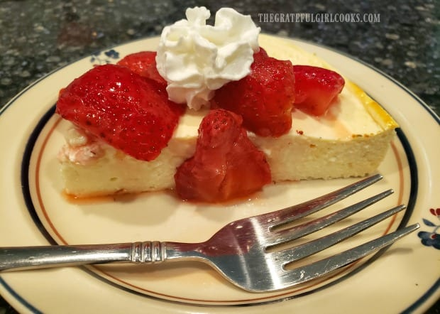 A slice of Freestyle 0 point cheesecake, with strawberries and whipped cream.