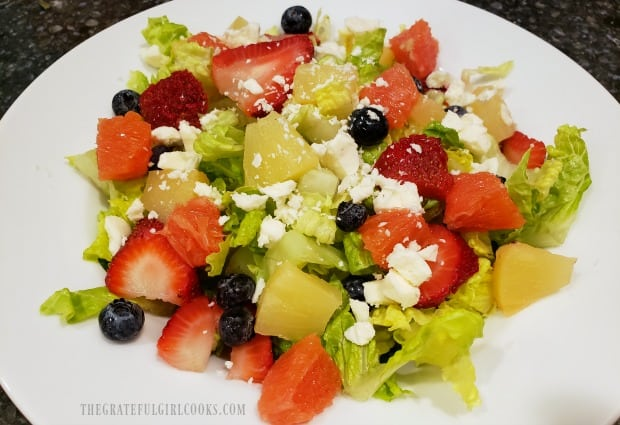 Fruit Feta Green Salad with candied pecans is ready for poppyseed dressing.