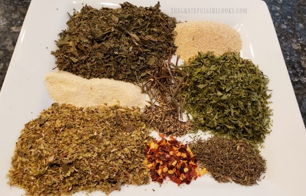 The spices used to make Italian seasoning mix, on a plate.