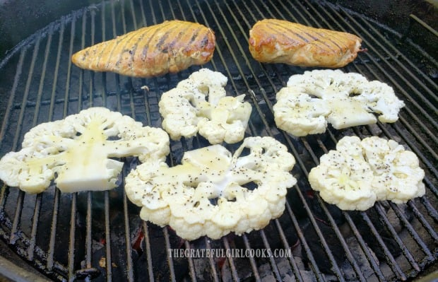 Cauliflower steaks are grilled on one side, then flipped over.