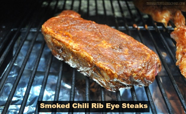 Use a Traeger, pellet smoker or BBQ to make delicious Smoked Chili Rib Eye Steaks. An easy, flavorful spice rub coats the smoked, then grilled steaks.