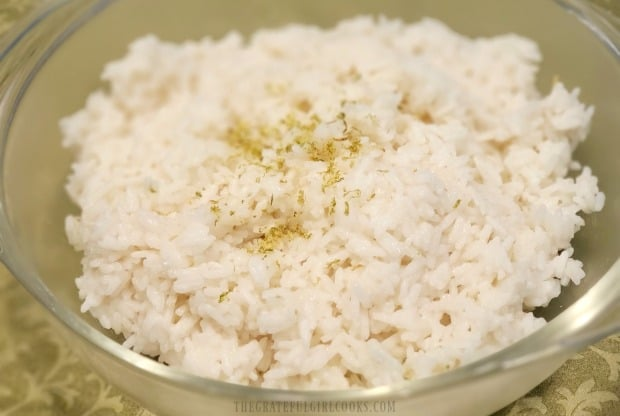 Time to serve the hot coconut lime rice with some chicken or shrimp on top!