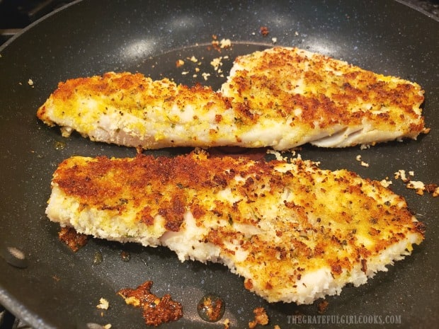 Panko custed fish is flipped and other side is cooked, as well.