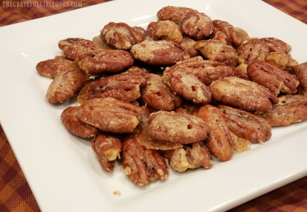The sugared curry ginger pecans are transferred to a platter to serve.