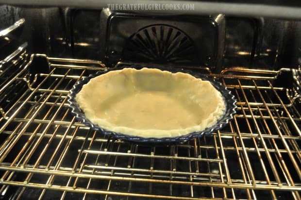 Pre-baking the bottom pie crust for a few minutes.