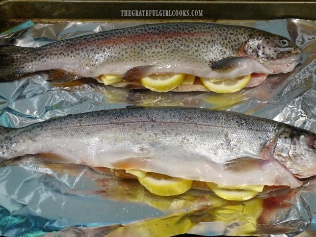 The trout is stuffed with garlic, lemon and butter before being grilled.