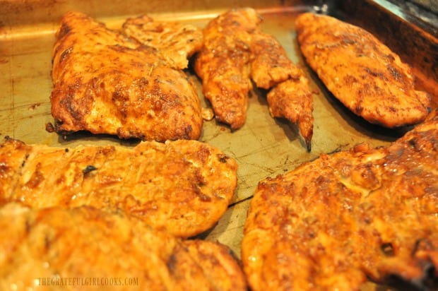 After grilling, the chili smoked chicken breasts rest before they are served.