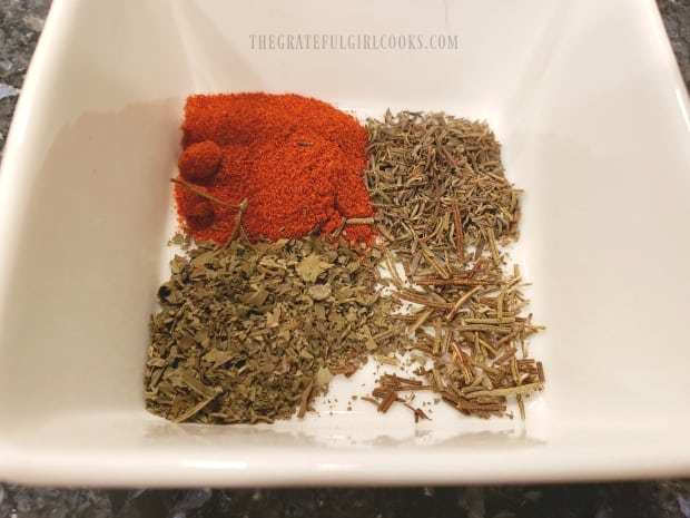 Paprika, thyme, basil, salt, pepper and rosemary are crushed for chicken seasoning mix.