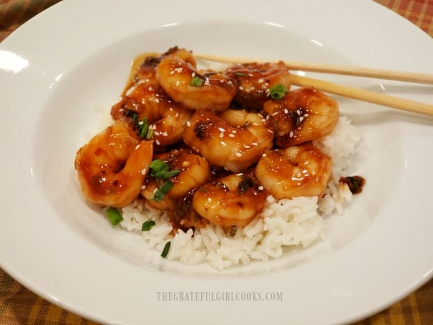 Once heated through, simple Szechuan shrimp dish is served on top of rice.