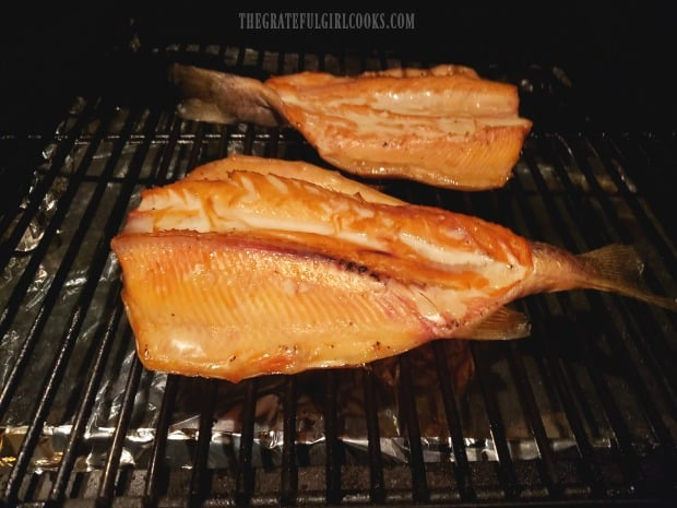 When done, Traeger smoked trout is beginning to flake and is opaque in color.