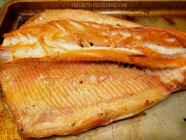 Here is one Traeger grill smoked trout, fully cooked, and ready to de-bone and eat!